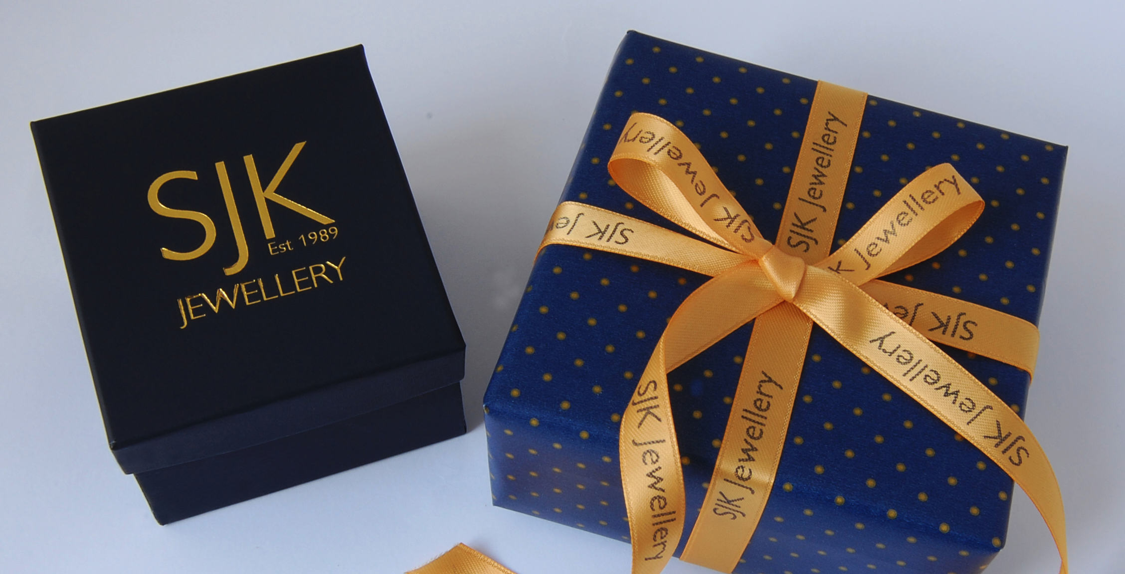 Antique-Gold-Ribbon-printed-with-Midnight-Blue-Company-Text-For-Christmas-Goft-Wrapping